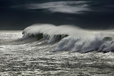 glistening: Windy wave in a glistening sea. Enhanced sky.