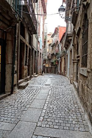 oporto: Traditional narrow street from Oporto. Morning light.   Stock Photo