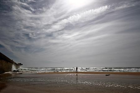 Backlit surfer analyzing sea conditions. Leca da Palmeira beach, north of Portugal (surf point) photo