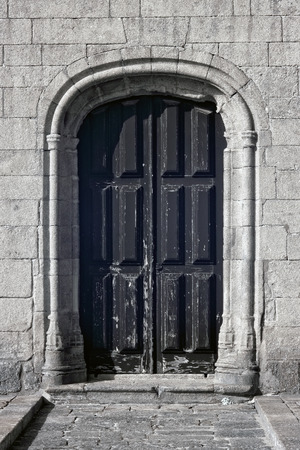 conde: Lateral door and stone work of the sixteenth century Azurara mother church, Vila do Conde, Portugal Stock Photo