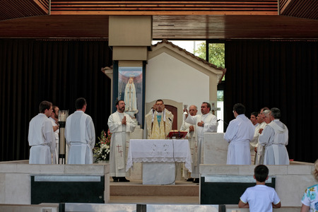 Fatima, Portugal - July 5, 2010: Ceremonial Mass at the Shrine of Fatima, Portugal, close to the Chapel of the Apparitions, with the presence of several priests and bishops
