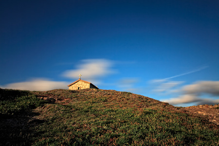 conde: Small chapel of St. Paio upon a hill by the sea at sunset, Labruge, rural zone of Vila do Conde, north of Portugal (long exposure)