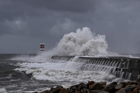 winter storm: Winter storm with big waves and dark sky at the mouth of the River Douro, Porto, Portugal