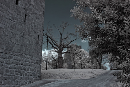 10th: Medieval Guimaraes castle from the 10th century, birth of the Portuguese Nation. Unesco site. Used infrared filter. Editorial