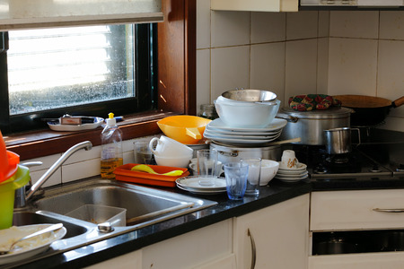 Dirty kitchen after lunch Stockfoto