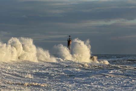 conde: Sea storm at winter sunset. River Ave mouth, Vila do Conde, north of Portugal.