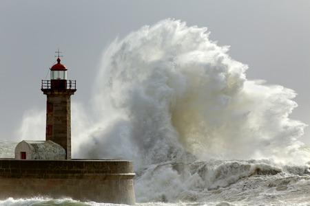 Big waves in a sunny storm. Portuguese north coast. 스톡 콘텐츠