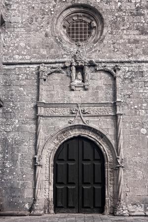 conde: Door, circular window and stone work of the sixteenth century Azurara mother church, Vila do Conde, Portugal Stock Photo