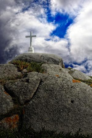 almighty: Stone cross on a hill (big cliff) against an enhanced dramatic sky