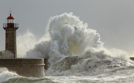 storms: Big waves in a sunny storm. Portuguese north coast. Stock Photo