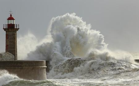 sea dock: Big waves in a sunny storm. Portuguese north coast. Stock Photo
