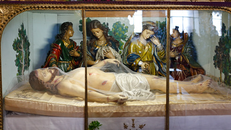 Porto, Portugal - March 4, 2015: Image of XIX century of dead Jesus situated in one of the side altars (Our Lady of Sorrows) of the beautiful Santo Antonio dos Congregados church, built in the beginning of the eighteenth century.