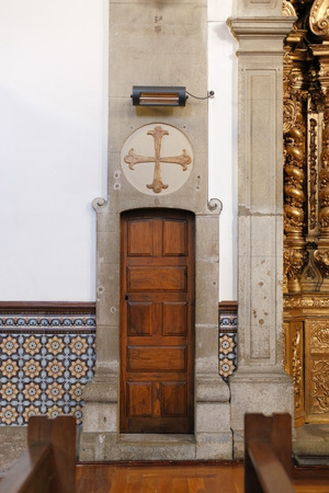 eighteenth: Porto, Portugal - March 4, 2015: One of the interior lateral door of the old St. Nicholas church. Church from XVII century, rebuilt in the eighteenth century. Neoclassical and baroque style. Stock Photo