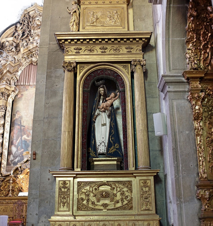 virgin mary mother of god: Porto, Portugal - March 4, 2015: Old image of the Madonna with the infant Jesus in her arms from St. Nicholas church. Church from XVII century, rebuilt in the eighteenth century. Neoclassical and baroque style.