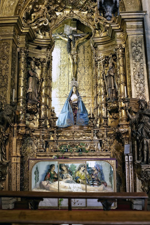our lady of sorrows: Porto, Portugal - March 4, 2015: Side altar of Santo Antonio dos Congregados church dedicated to Our Lady of Sorrows and the Passion and Death of Christ. Church built in the beginning of the eighteenth century. Editorial