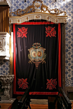 respectable: Porto, Portugal - March 4, 2015: Symbol of ancient (century. XV), respectable and charitable brotherhood of Our Lady of Mercy embroidered on a beautiful curtain of his house, Church of Mercy of Porto.