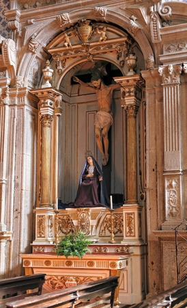 eighteenth: Porto, Portugal - March 4, 2015: Side altar of Misericordia do Porto church dedicated to Our Lady of Sorrows and Christs crucifixion. Church rebuilt by Nasoni in the eighteenth century in baroque style. High ISO photo.