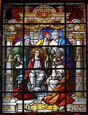 scholars: Porto, Portugal - March 23, 2015: Stained glass window from  church of Lapa representing a biblical scene from the New Testament, young Jesus among scholars Editorial