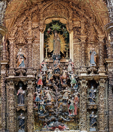 surmounted: Porto, Portugal - March 23, 2015: Family tree of Jesus Christ in the Bible, Tree of Jesse (since Jesse, the father of King David), surmounted by the Immaculate virgin with the infant Jesus in her arms. Work of the early eighteenth century. Church of St. F