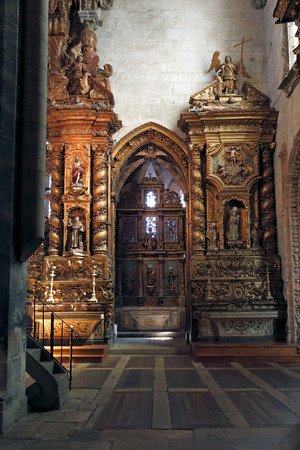 eighteenth: Porto, Portugal - March 23, 2015: Interesting detail of the ancient and monumental church of San Francisco, seeing part of the wood work, gilt, and some of her saints, many of them from the Eighteenth Century. High ISO photo.