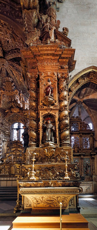 eighteenth: Porto, Portugal - March 23, 2015: Interesting detail of the ancient and monumental church of San Francisco, seeing part of the wood work, gilt, and some of her saints (many of them from the Eighteenth Century).