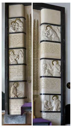 high priest: Porto, Portugal - March 23, 2015:  Beautiful bas-relief with scenes from religious life of St. Anthony of Padua and Lisbon that frames a side niche, small altar, of the Congregados church (high ISO photo)