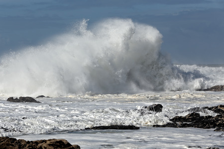 breaking wave: Big breaking wave in a sunny noon. Portuguese coast. Stock Photo