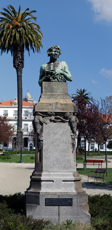 bacchus: Porto, Portugal - March 23, 2015: Bacchus statue of the Republic Square Garden. 1916 Statue of the artist Teixeira Lopes (father) that celebrated the 6th year of the implementation of the Portuguese Republic.