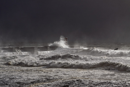 sea dock: Dark sea storm at the mouth of Douto river, Porto Stock Photo