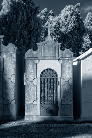 chapel: Old european cemetery chapel. Infrared. Toned blue.