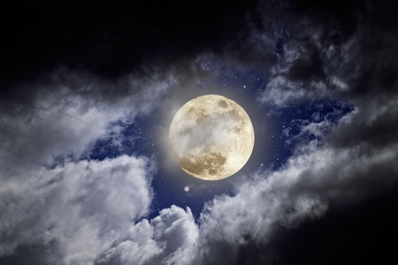 Full moon in a cloudy night with stars