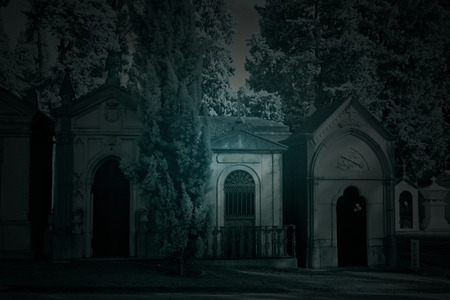Spooky old european cemetery by night