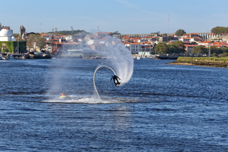 conde: Vila do Conde Portugal  May 16 2015: Flyboard training and demonstration in the mouth of the Ave river