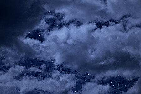 night sky: Night sky with stars between the holes of the clouds