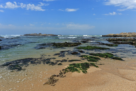 spring tide: Beautiful sunny beach from the north of Portugal during low tide Stock Photo