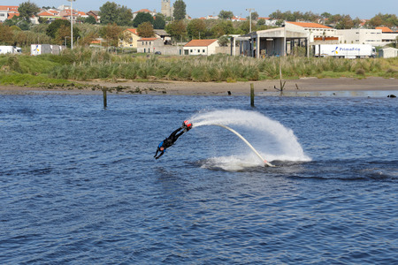 conde: Vila do Conde, Portugal - May 16, 2015: Flyboard training and demonstration in the mouth of the Ave river Editorial