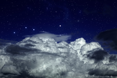 Starry night sky with strong clouds in the foreground