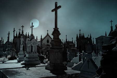 graves: Old european cemetery in an overcast full moon night