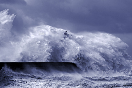 Heavy storm at the mouth of Douro river, Porto, Portugal. Black and white toned blue.