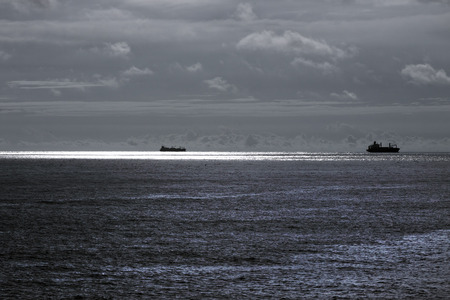 glistening: Infrared glistening seascape with ships on the horizon