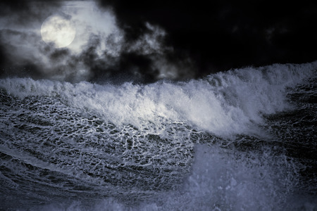 granola: Detailed photo of a big stormy wave crashing over the coast Foto de archivo