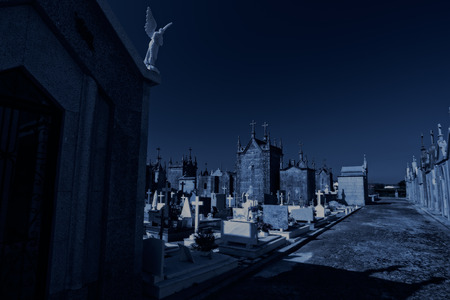 angel cemetery: Old european cemetery at night. Used digital filters. Stock Photo