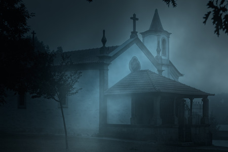 old church: Old european catholic chapel in a foggy night Stock Photo