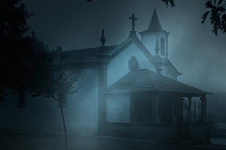 catholic chapel: Old european catholic chapel in a foggy night Stock Photo