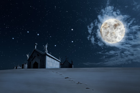 moon angels: Hallowwen background with footprints in the foreground towards a cemetery in a clear starry full moon night Stock Photo