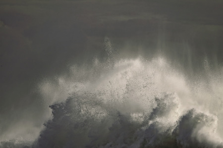 dark sky: Detailed big breaking wave in an early autumn stormy afternoon. Portuguese coast