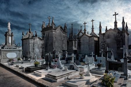 enhanced: Old european cemetery. Enhanced sky. Stock Photo