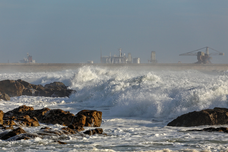 the flood tide: Leca da Palmeira beach, north of Portugal, with rough sea in a beautiful sunny day. Flood tide. Surf point.