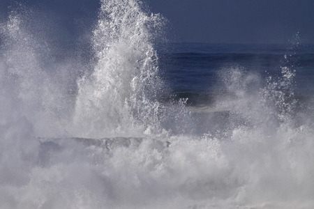 stormy sea: Splash from stormy sea waves breaking against north portuguese coast