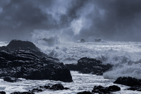 at sea: Typical sea storm from northern portuguese coast. Slightly enhanced sky. Toned blue. Stock Photo